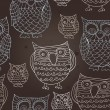 Seamless pattern with doodle owls - vector illustration — Stock Vector