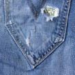 Hole in the jeans pocket — Stock Photo