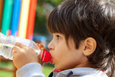 Little boy drinking pure water — Stock Photo