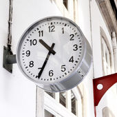 Clock at railway station — Stock Photo