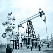 Pump jack and oilwell. — Stock Photo