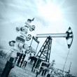 Stock Photo: Pump jack and oilwell.