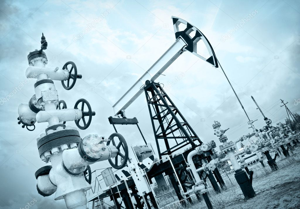 Extraction of oil. Pump jack and oil wellhead. Toned. — Stock Photo #9281683