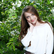 Stock Photo: Young woman in the apple garden