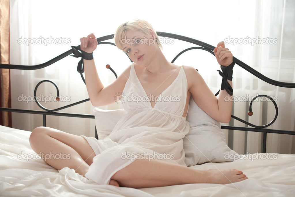 Woman bondage on the bed — Stock Photo #10344653