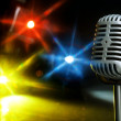 Retro microphone with spotlight — Stock Photo