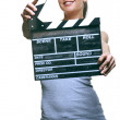 Attractive young woman with movie clapper — Stock Photo