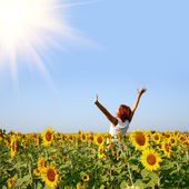 Redhaired woman in sunflower field — Stock Photo