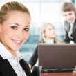 Business woman in an office environment — Stock Photo