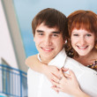 Stock Photo: Happy young couple and home