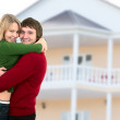 Happy young couple and home — Stock Photo #9016536