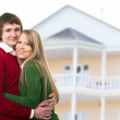 Happy young couple and home — Stock Photo
