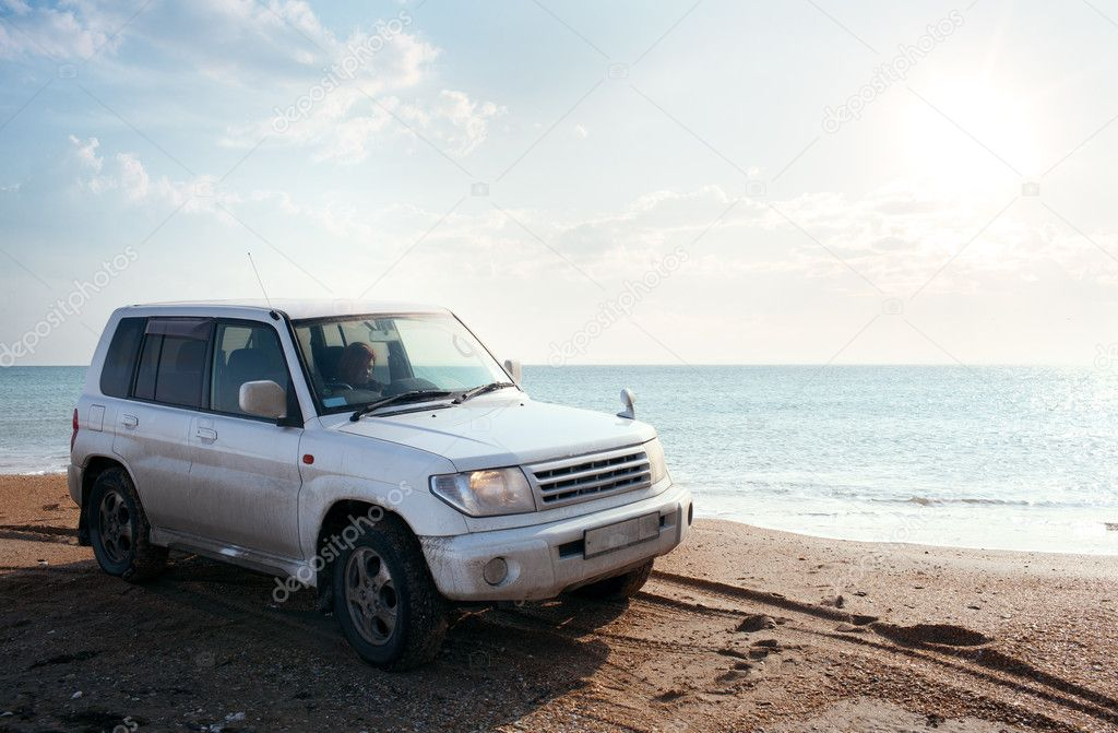 Off-road vehicle on the  sandy beach — Stock Photo #9098086