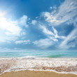 Sea beach and blue sky — Stok fotoğraf