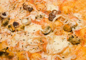 Italian pizza with seafoods — Stock Photo