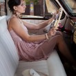 Woman in the vintage car - Stock Photo