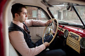 Man in the vintage car — Stock Photo