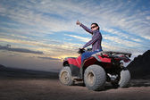 Girl on atv — Stock Photo