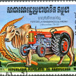 Stock Photo: KAMPUCHE- 1983: shows bull and tractor