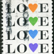 "USA - CIRCA 1984: shows word ""love"" with stylized hearts - Photo"
