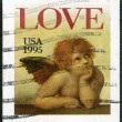 "USA - 1995: shows word ""love"" and Cherub from Sistine Madonna, b - Stock Photo"