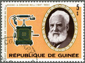 GUINEA - 1976: shows Alexander Graham Bell (1847-1922), telephon — Stock Photo