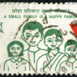 INDIA - CIRCA 1980: A stamp printed in India shows A small famil — Stock Photo