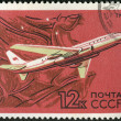 A stamp printed by USSR shows turbojet-powered Soviet airliner TU-104 — Stock Photo