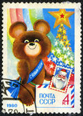 USSR - CIRCA 1979: shows Olympic Bear Holding Stamp — Stock Photo