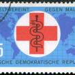 GERMANY - CIRC1963: shows map, cross and staff of Aesculapius — Stock Photo #9029103