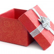 Open red gift box with silver ribbon — Stock Photo