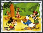 SHARJAH & DEPENDENCIES - CIRCA 1972: shows Mickey Mouse and friends — Stock Photo