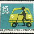 GERMANY - 1966: shows automobile and child with scooter — Stock Photo
