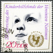 GERMANY - 1971: shows Child's Head and UNICEF Emblem — Stock Photo
