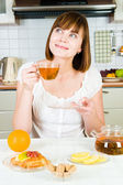 Young beautiful happy woman with tea — Stock Photo