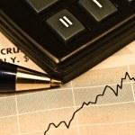 Business concept: calculator, pen and diagram — Stock Photo #8154570