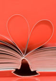 Pages of a book curved into a heart shape — Stock Photo