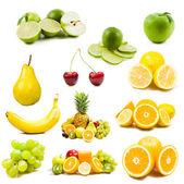 Lot of fresh fruits isolated on white — Stock Photo