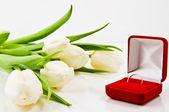 White Tulips and wedding ring — Stock Photo