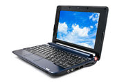 Modern and stylish laptop computer with blue cloudy sky wallpape — Stock Photo
