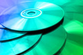 Background of some colorful compact discs — Stock Photo