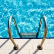 Swimming pool steps - Stock Photo