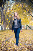 Woman walking in a park. Autumn season. — Stock Photo