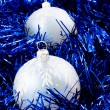 Blus balls and tinsel — Stock Photo