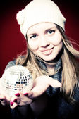 Portrait of beautiful blond young woman and christmas ball on — Stock Photo