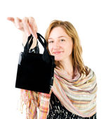 Happy young woman with shopping bag — Stock Photo