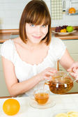 Portrait of young beautiful happy woman with tea — Stock Photo