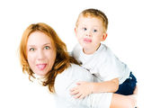 Woman and son Sticking Tongues Out — Stock Photo