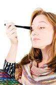 Pretty woman applying make up. — Stock Photo