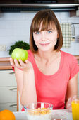Beautiful woman and green apple — Stock Photo